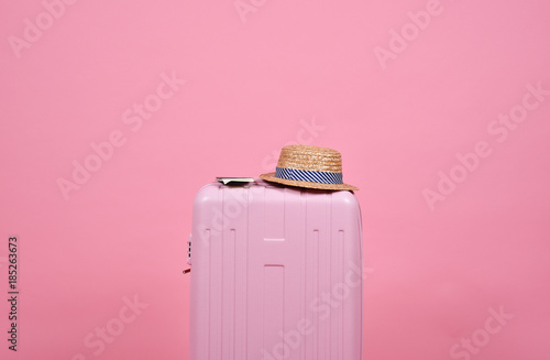Traveler pink suitcase and passport document over pink background, Journey and travel concept. - 185263673