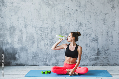 Fitness woman relax after exercise.