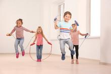 Cute Children Skipping Rope In Light Room