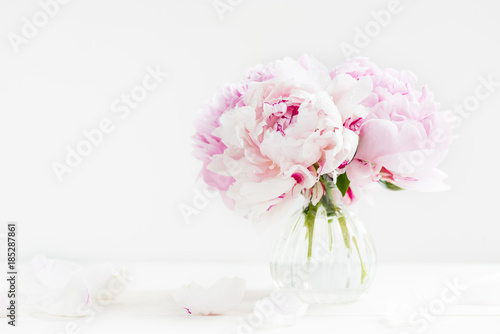 Fresh bunch of pink peonies on light background