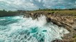 Timelapse Huge waves break about the rocks on the island Nusa Ceningan, Indonesia