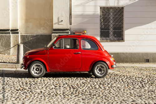 Keuken foto achterwand Vintage cars Red vintage italian car parked in the city center
