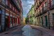 Empty street with colorful old buildings during early morning un