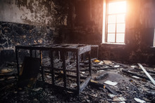 Burned Room Interior In Apartment House. Burned Furniture And Charred Walls In Black Soot