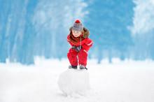 Little Boy In Red Winter Cloth...