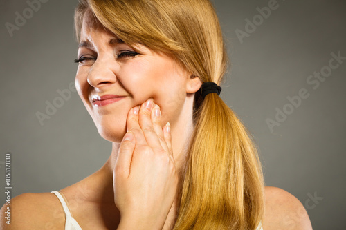 Woman suffering from tooth pain Wallpaper Mural
