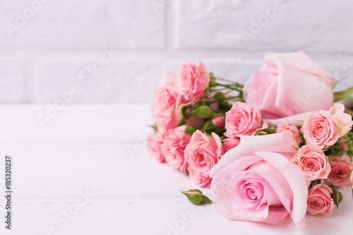Tender pink roses flowers  on  white wooden background. Canvas Print