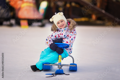 little girl riding on snow-cats