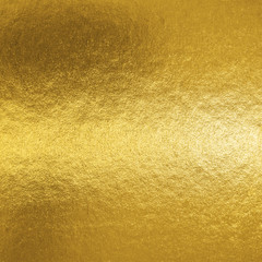 Fototapeta Gold foil leaf shiny metallic wrapping paper texture background for wall paper decoration element
