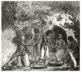 Ancient native americans cooking and smoking in the deep forest wearing their semi naked costumes. Created by Chassevent after previous gravure by unknown author on Le Tour du Monde Paris 1862