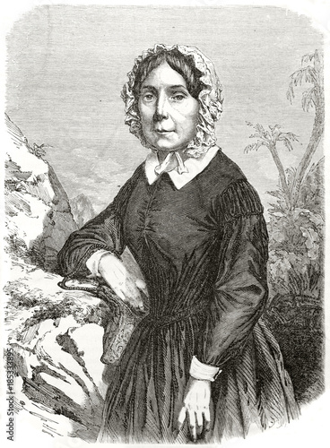 Photo Ancient old serious woman posing in colonial clothes, white cap and black dress