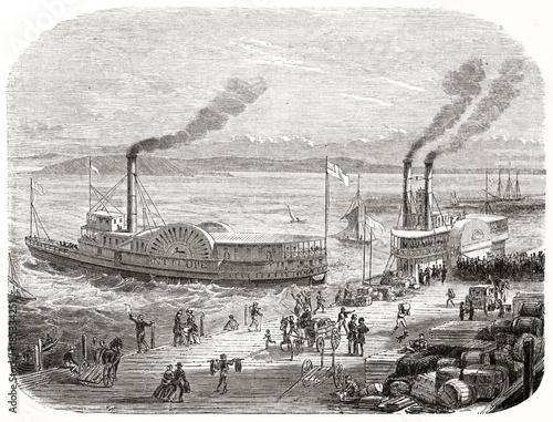 Valokuva Ancient San Francisco docks, California, with a steamboat that sets sail