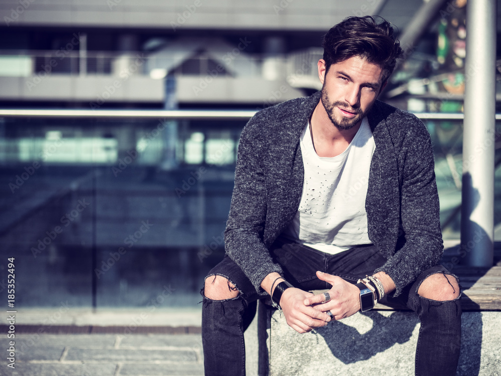 Fototapety, obrazy: One handsome man in urban setting in European city, sitting