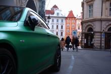 Nice Green Sport Car In A Prague Cityscape. Czech