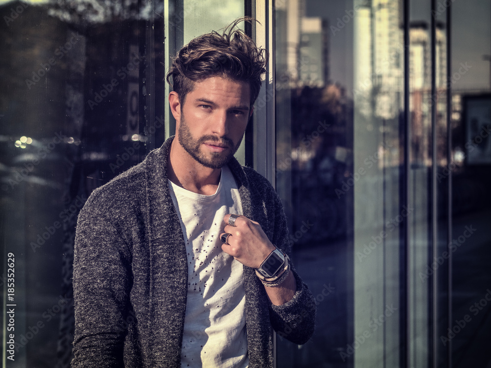 Fototapety, obrazy: One handsome young man in urban setting in European city, standing