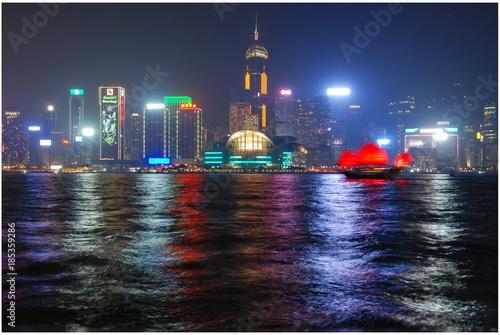 View from Tsum Sha Tsui promenade to Hong Kong illuminated skyscrapers at night Canvas Print