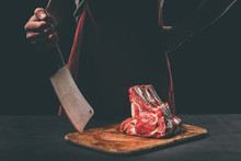 Butcher With Cleaver And Raw M...