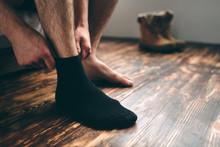 The Man Wears Black Socks. Men...