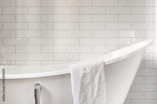Towel on classic bathroom with white bathtub Fototapet