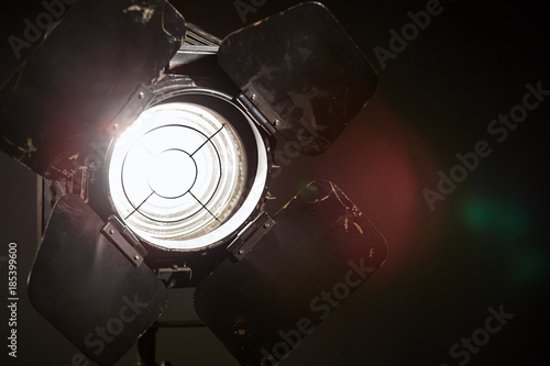 Fotografie, Obraz  Old film projector/ Old film projector shines in the studio