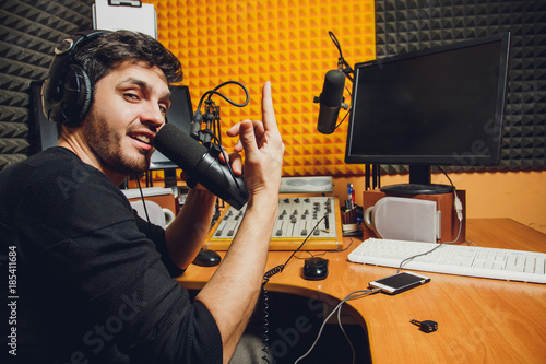 Microphone in radio studio and presenter on background Canvas Print