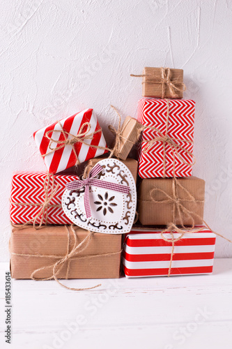 Wrapped colorful gift boxes with presents and decorative heart