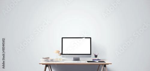 Fototapeta  Computer display and office tools on desk.