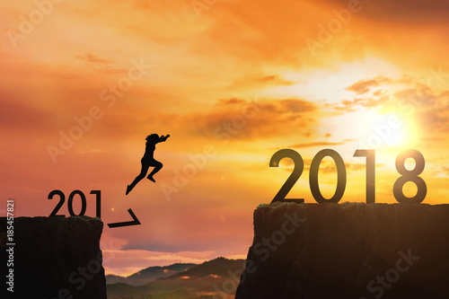 Fototapety, obrazy: Siluate woman jumping from 2017 cliff to 2018 cliff on sunrise time : meaning to going to year 2018