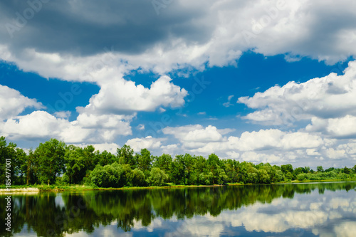 Fototapeta Beautiful summer rural landscape with river and clouds on the blue sky. Russia. Ural. Village Sloboda obraz na płótnie