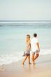 Couple Walking on Beach on Vacation