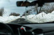 A look through the window of a car. Winter season, winter road. Snow catastrophes, risky dangers during driving.