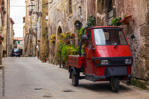 Spoed Foto op Canvas Aap Piaggio Ape at the empty street