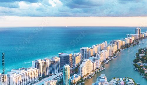Miami Beach skyscrapers at dusk, Florida. Beautiful view from helicopter