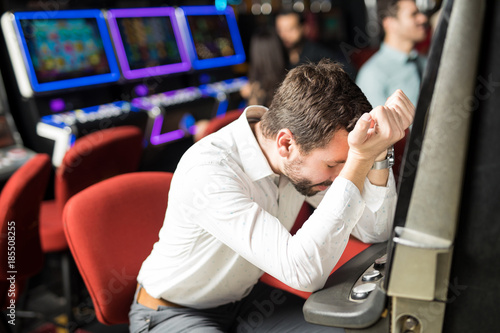 Stressed man losing money in a casino Canvas-taulu