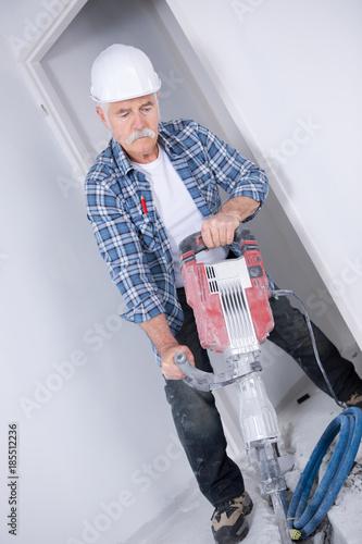 Fotografia, Obraz  Senior man using pneumatic drill