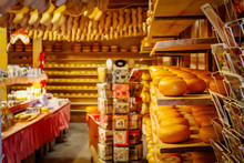 Souvenir Shop In Netherlands With Cheese And Wooden Shoes On The Shelves. Tradition Holland Klompen And Clogs.