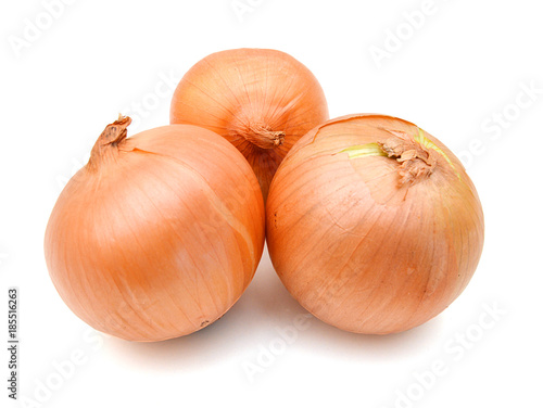 Photo  Three onion bulbs isolated on white background