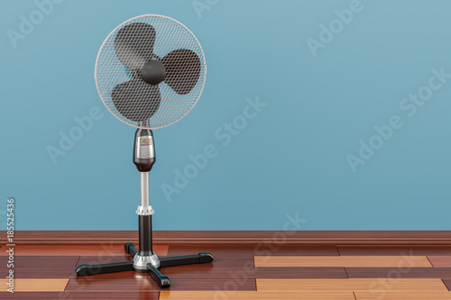 Standing pedestal electric fan in room on the wooden floor, 3D rendering - 185525436