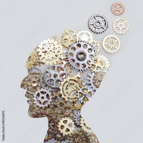 Photo Brain model concept made from gears and cogwheels on grey background