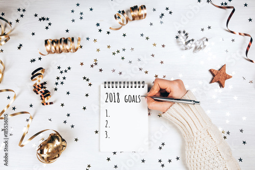 Photo  Holiday decorations and notebook with 2017 goals