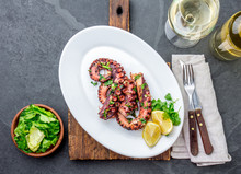 Grilled Octopus On White Plate...