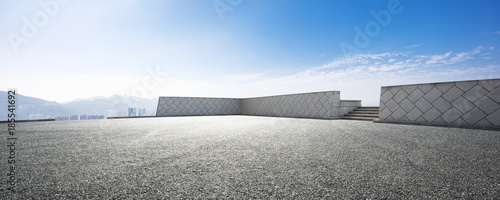 Leinwand Poster empty asphalt road with cityscape of modern city