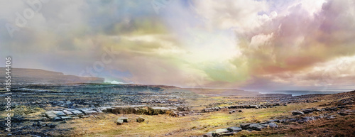 Fotografie, Tablou Panoramic Irish landscape with stones, grass and  cloudy sky