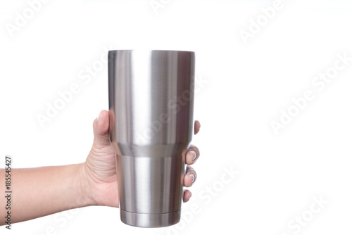 Hand holding stainless steel thermos mug for keeping  temperature like iced of hot water