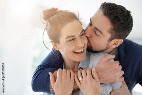 Cheerful romantic couple of lovers cuddling Fototapet