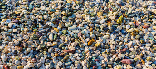Colorful Wet Pebble Beach Background