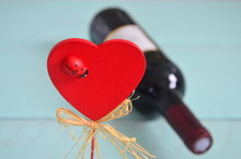 Red Wooden Heart And A Ladybug In A Turquoise Background.