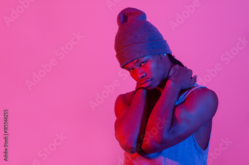 Young black man in purple background