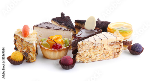 Variety of tasty sweets on white background