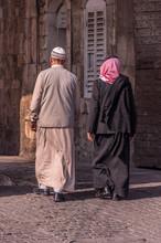 Two Men Wearing Arabic Clothes Walking In Jerusalem, Israel